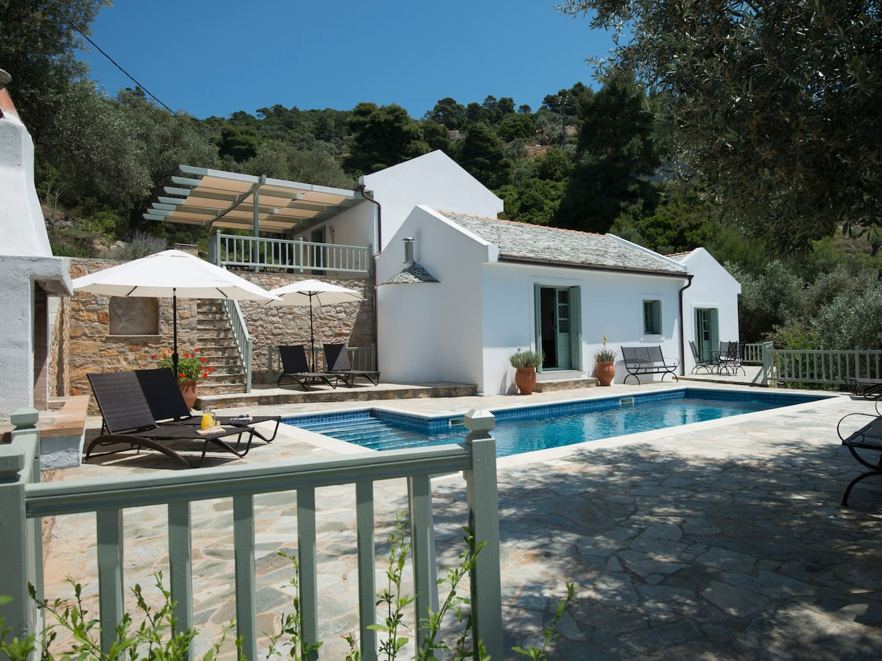 Front shot of the villa , the traditional bbq  is to the left of the photo, there is now a new patio relaxation terrace to the right of the picture with outside kitchen  and fridge , large space for sun bathing and dining ,