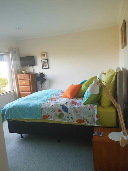 Sunny, spacious master bedroom with new queen size bed and quality bedding.