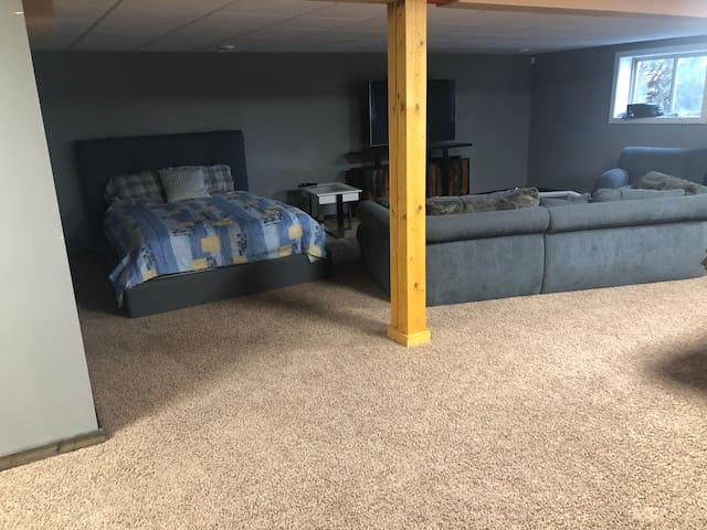 Queen bed in basement
