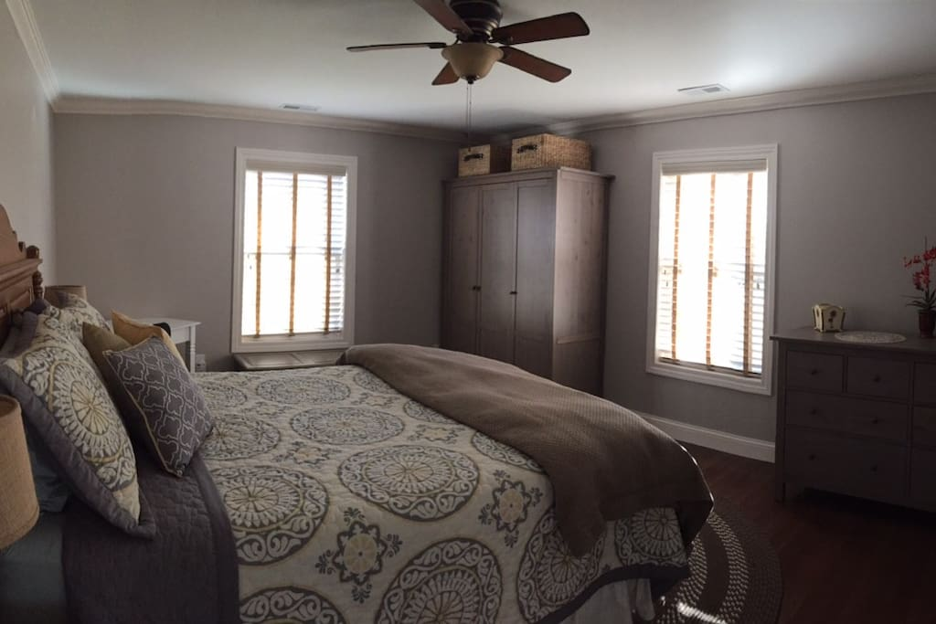 The master bedroom is quite large has desk for working in solitude form your other guests.