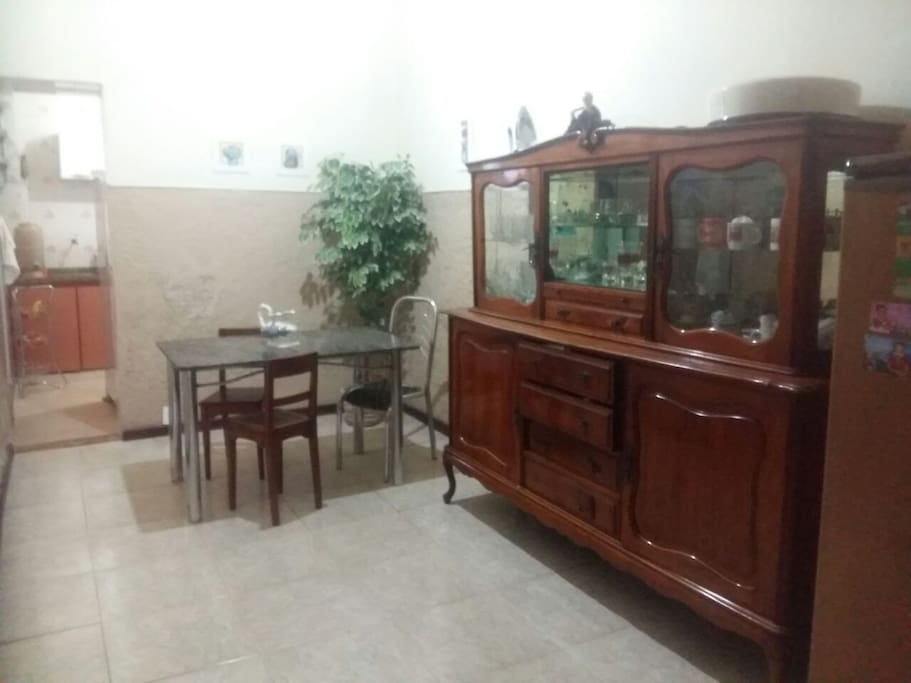 Second room with a vintage cabinet and a table