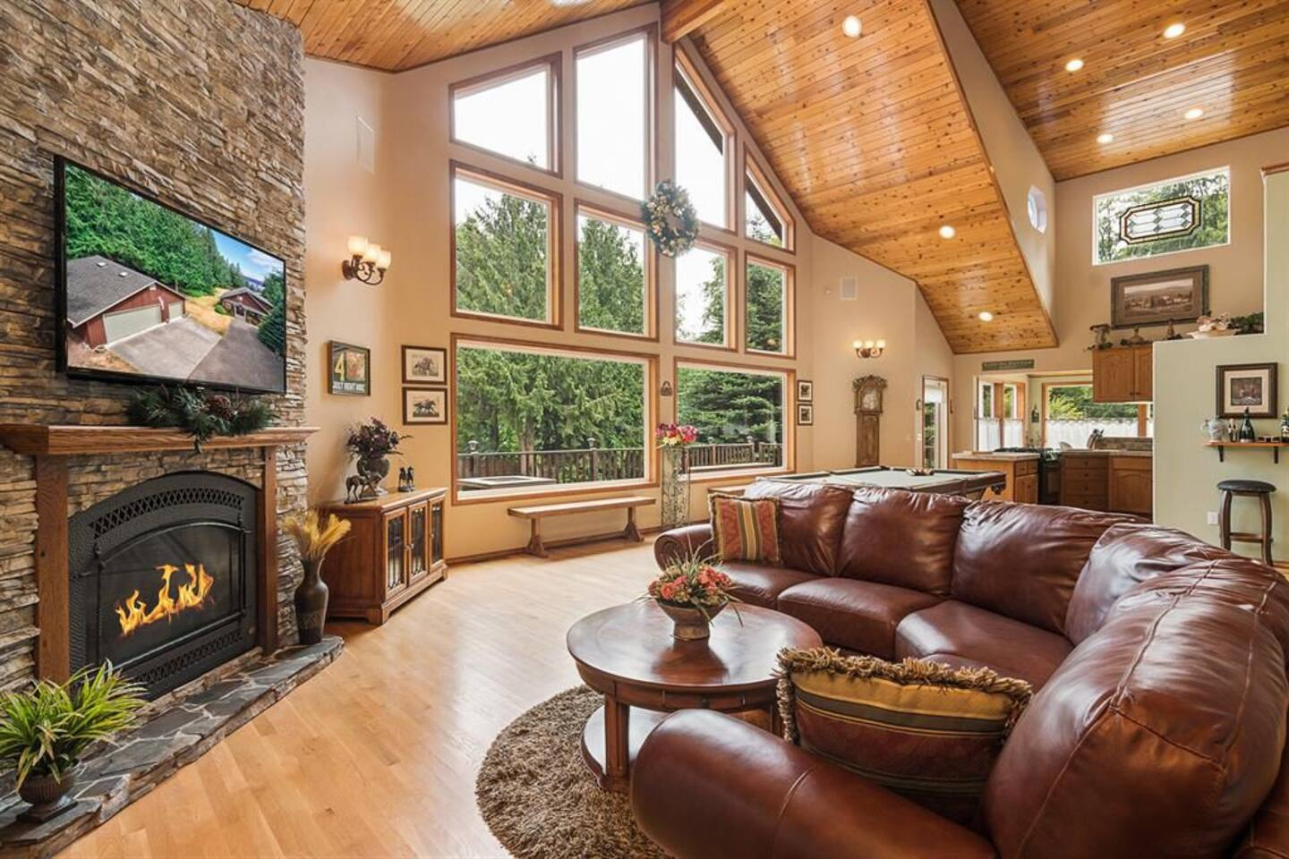 Large Picture Windows in Main Living Area With Cozy Gas Fireplace