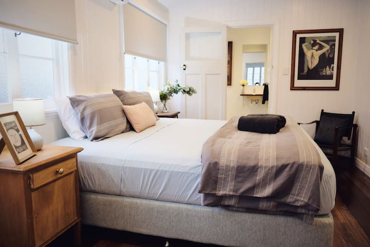 Main bedroom with luxurious KS bed and ensuite with walk in robe, TV and bedside charging station
