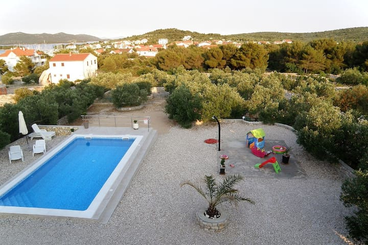 Spacious apartment with panoramic sea view, shared swimming pool and garden, BBQ