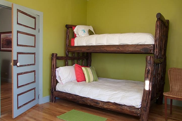 Custom-made bunks: Double size on the bottom with twin size on the top.