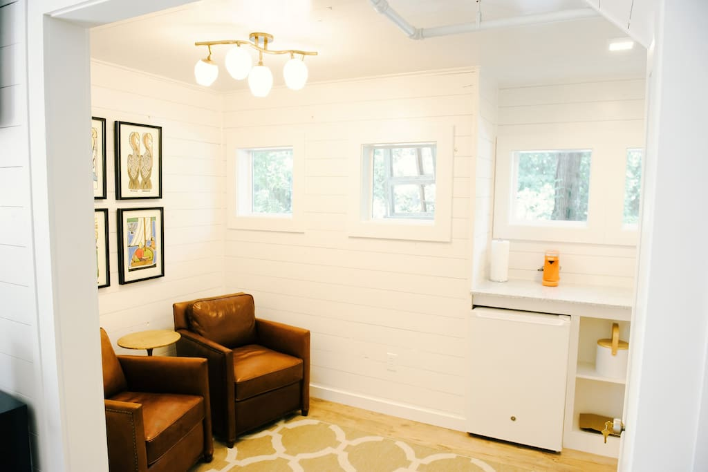 Separate lounging area with mini-kitchen, frig & microwave
