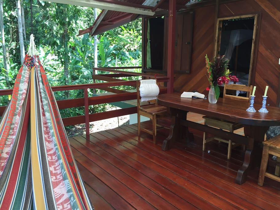 Covered Patio with dining area and hammock