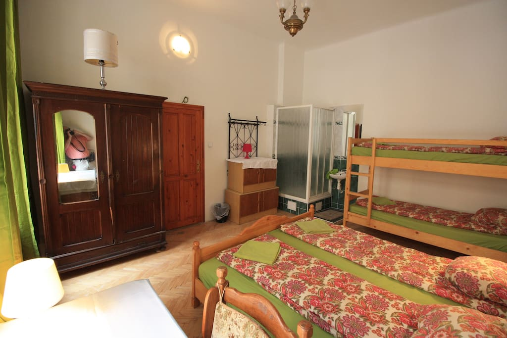 bedroom D8 , 4 beds ,writing desk, wardrobe, shower unit , ideal for couples