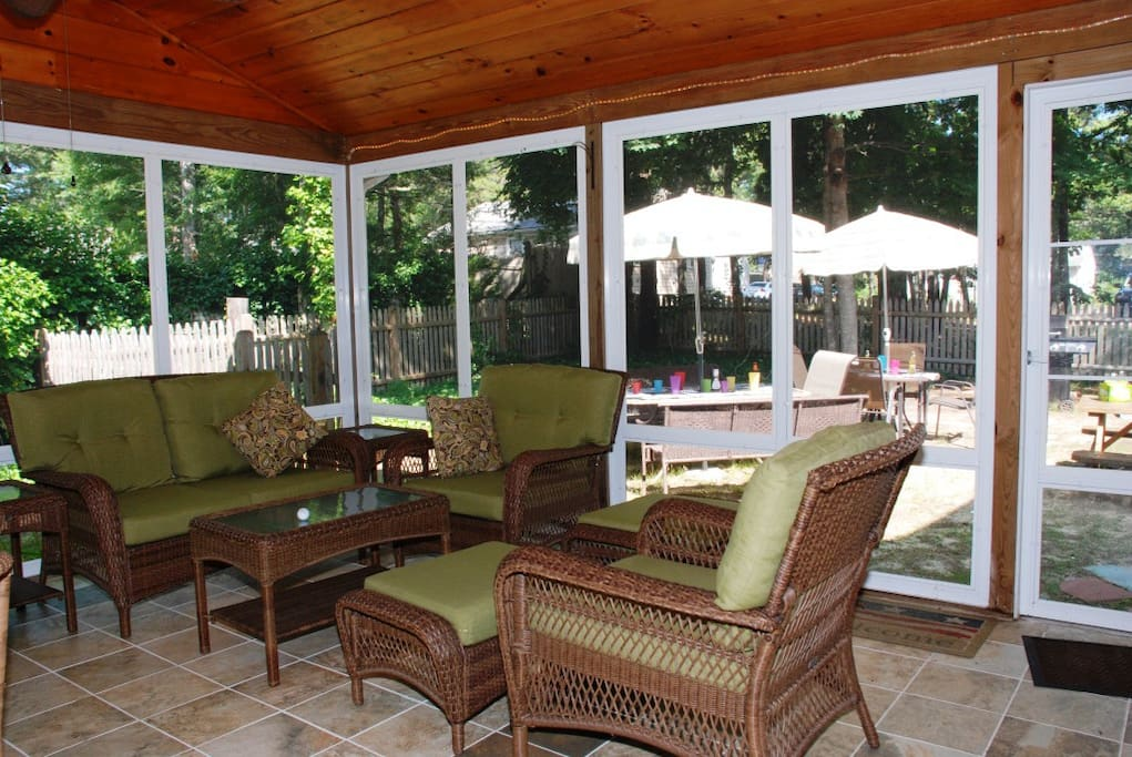 Awesome porch with seating for 10.  Overlooks outdoor picnic and BBQ area.