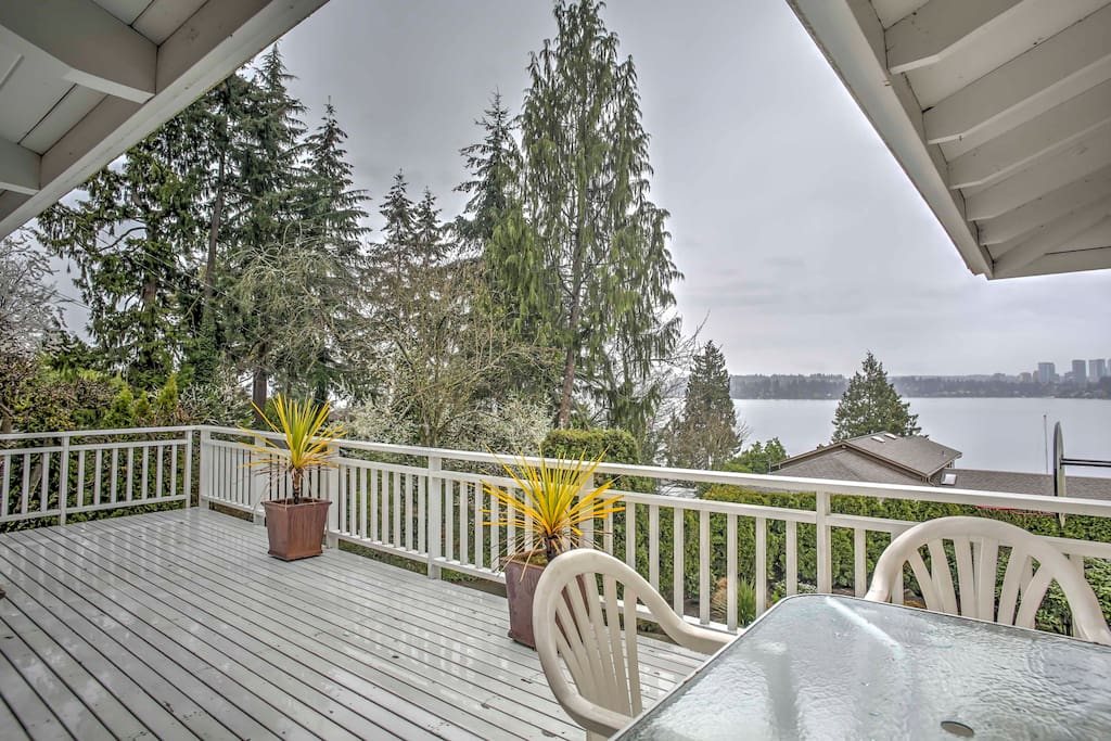 The spacious deck is complete with a patio table, chairs and excellent views of Lake Washington and downtown Bellevue.