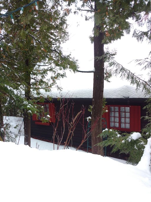 The Red Door Chalet is a tradition Quebec  timber  frame house full of old world charm.