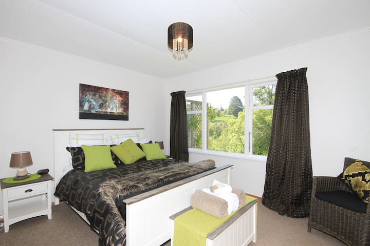 Main Valley View Bedroom with Goose Down Bedding and built in Wardrobe