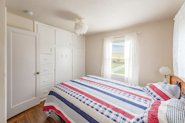 Down stairs bedroom with queen bed