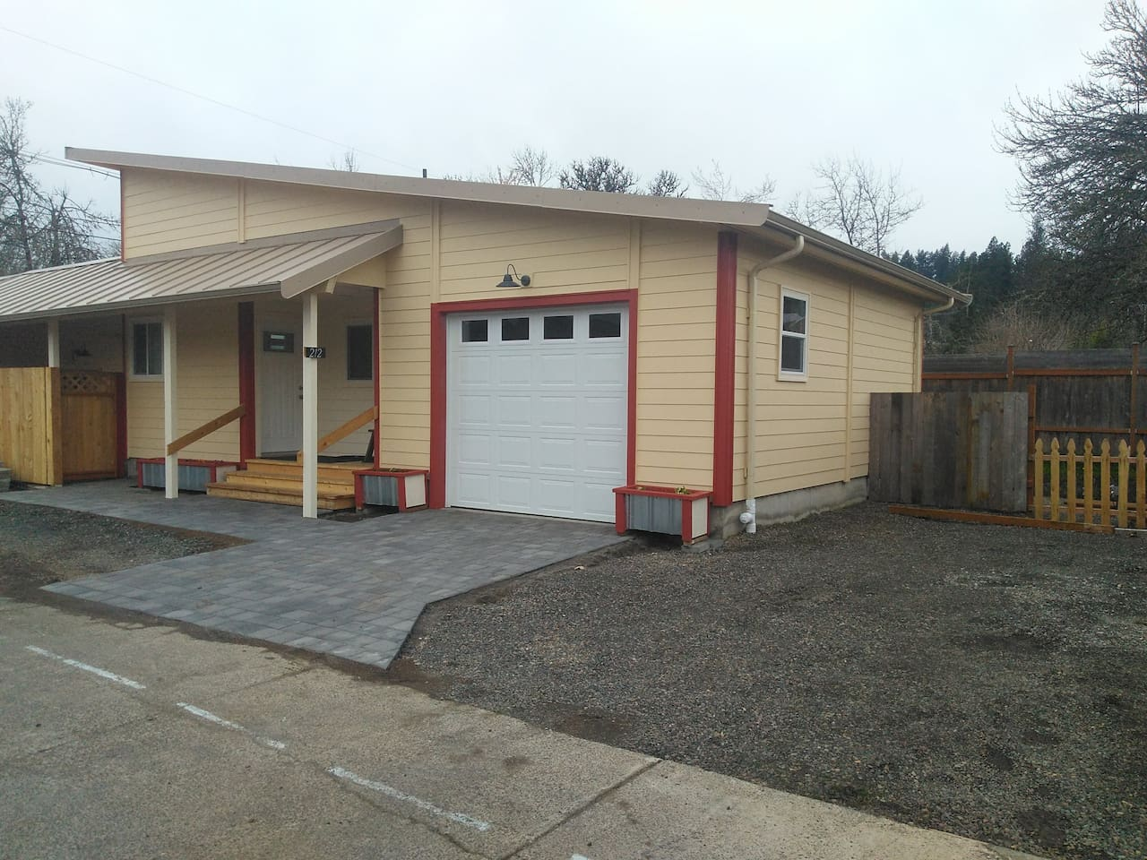 Front of house, with garage and extra parking.