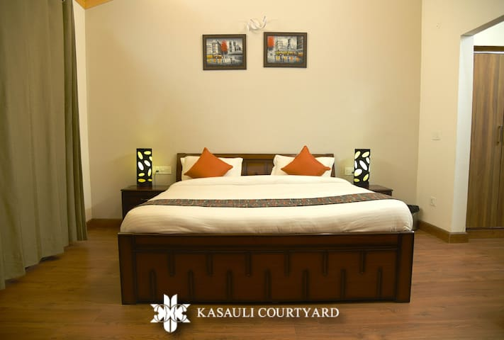Super Deluxe room with a walk in closet, balcony is perfect to wind up after enjoying Kasauli all day. It just feels like home.