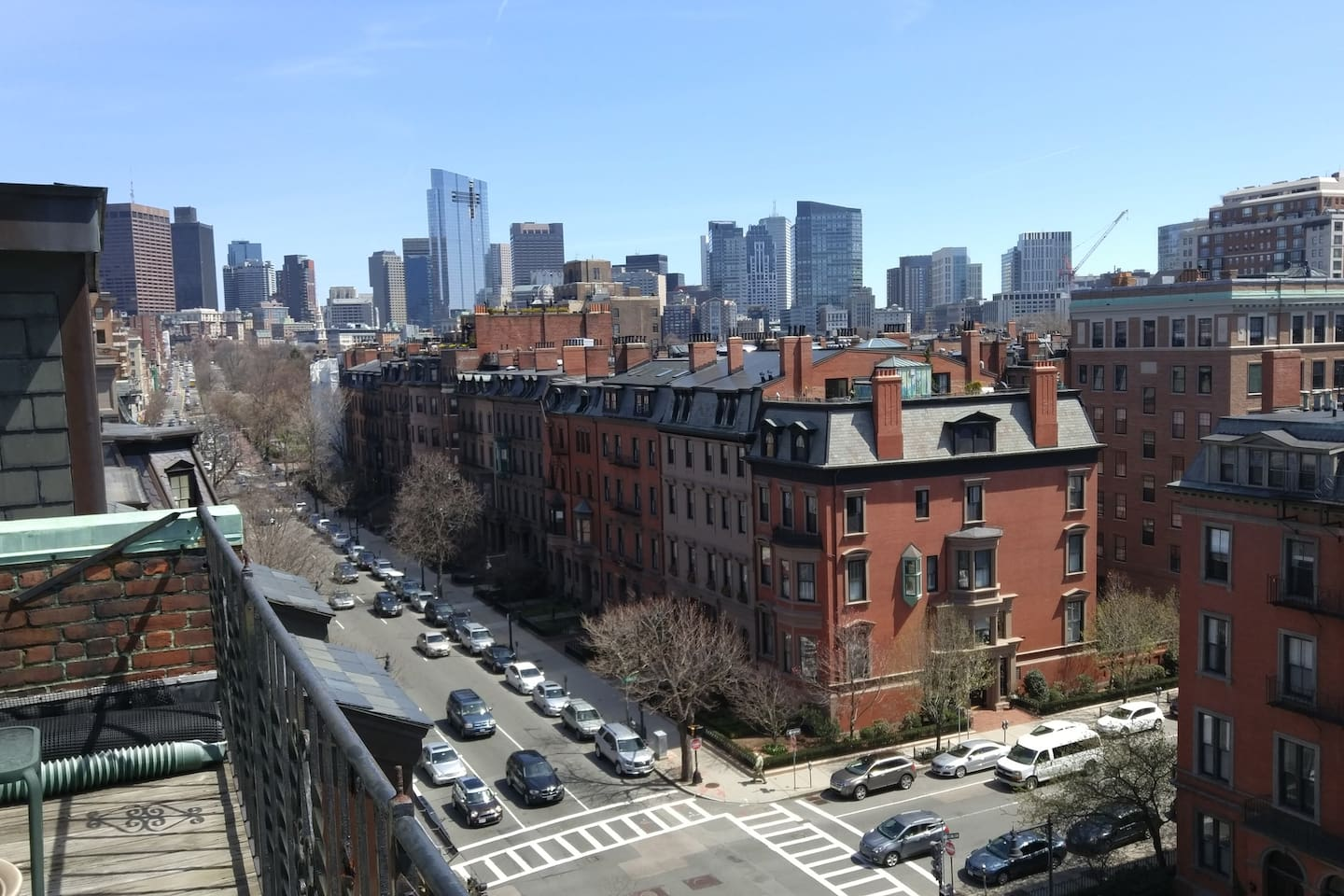 City views from the private front balcony overlooking Beacon Street.