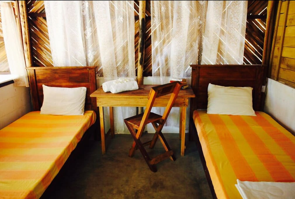 Cabana 2 comes with twin beds, mosquito nets, ensuite and fan.