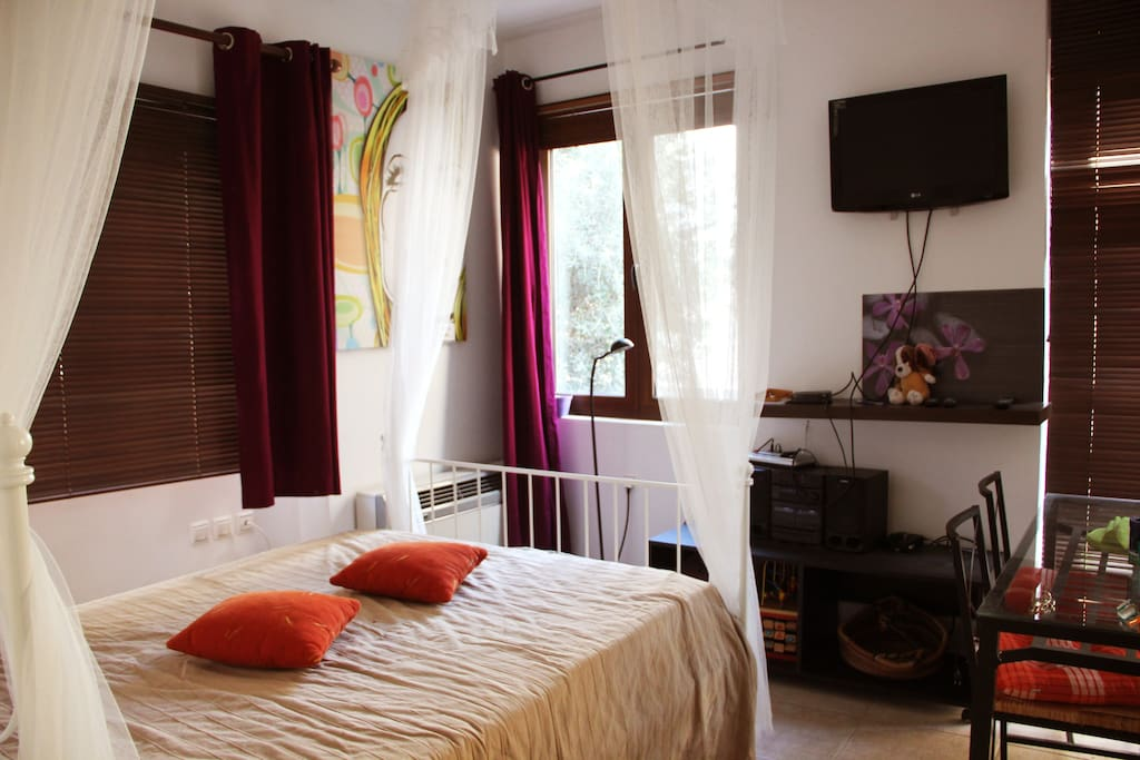 Sunny room with double bed.