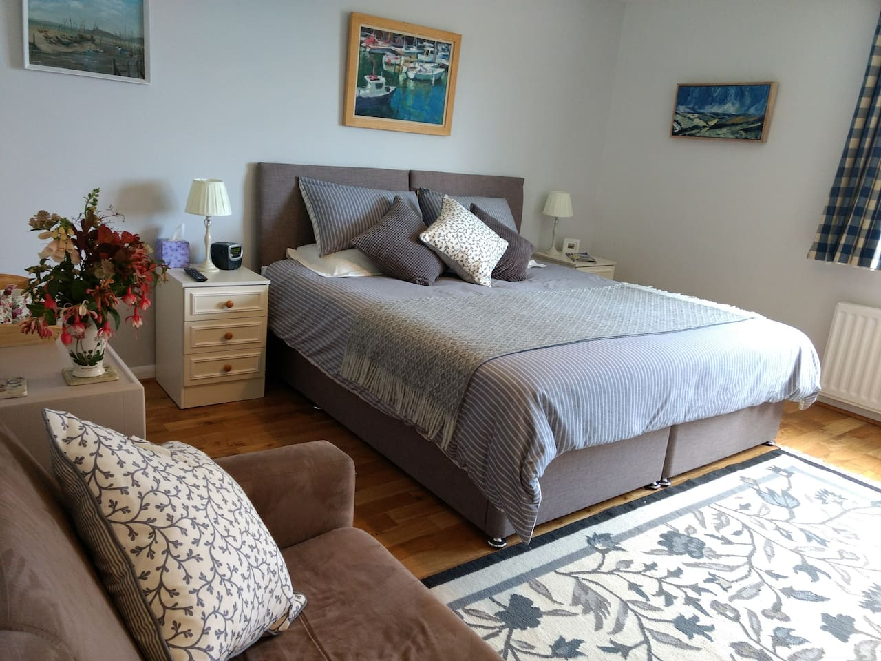 Our stylish Curlew Room offers flexible family accommodation with a sumptuous super-king bed that splits to make twins, plus comfy double sofabed.