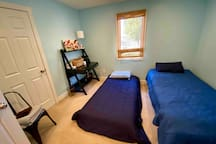 Bedroom. You can use two twin beds or we can trundle one of them underneath the other. Desk & Chair workspace.