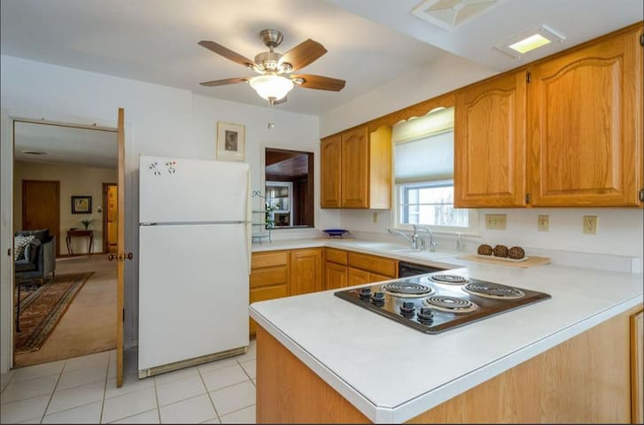 large, well-layed-out kitchen with dishwasher, cook top stove