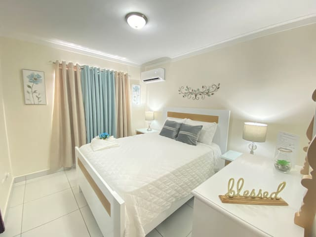 - Master bedroom . It has a queen sized  bed, it's own  bathroom,  with a spacious  walking closet  , mirror dresser - A/C