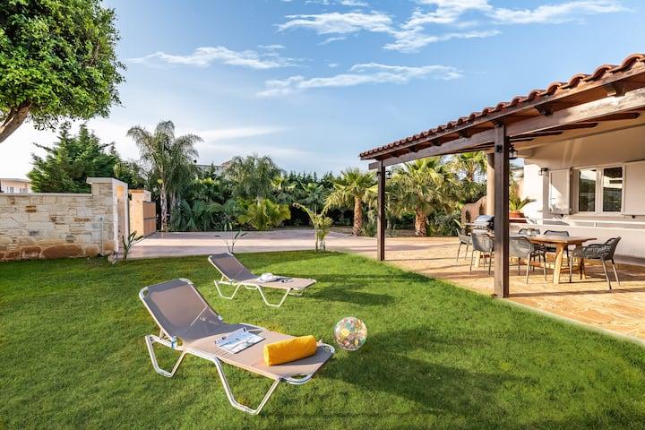 Tropical Garden House, with a lush green garden