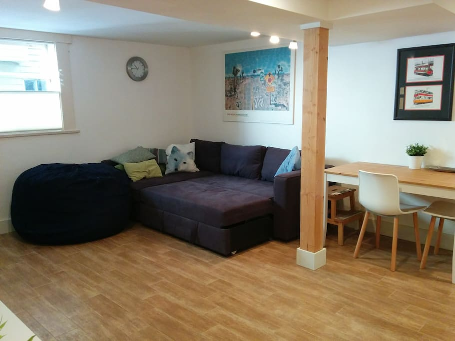 Spacious, light-filled living room. Sofa coverts to a sofa-bed, plus giant bean bag..