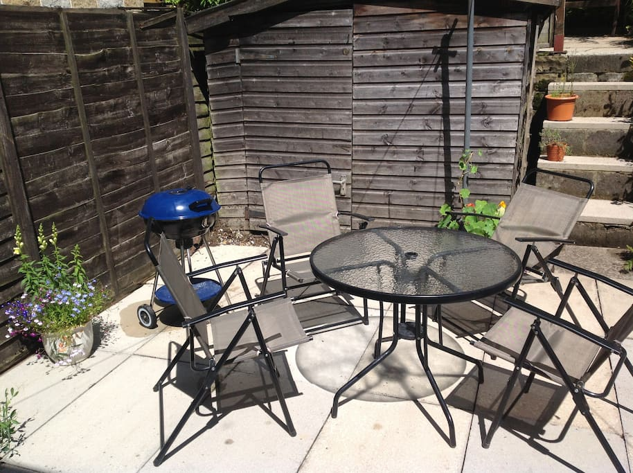 Patio garden with garden furniture and bbq set