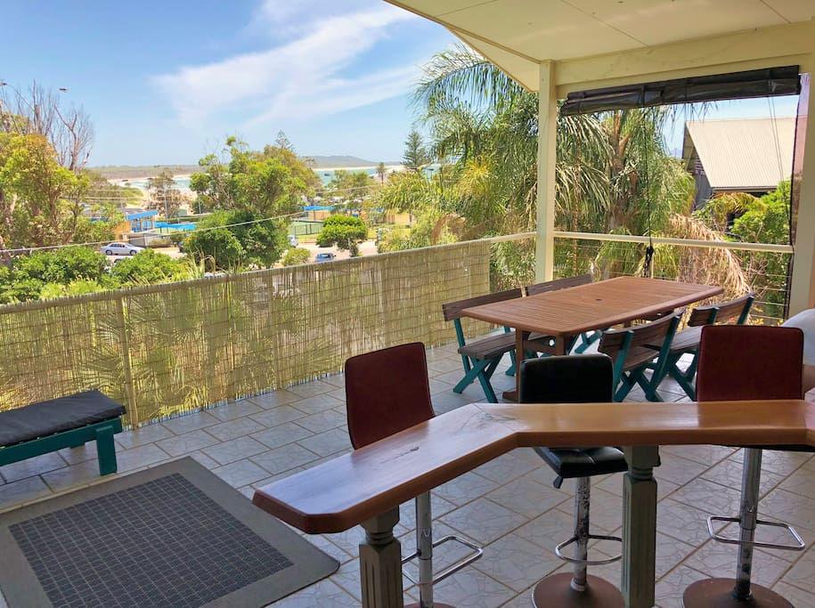 Deck with ocean views. Outdoor eating area (seats 10) and bar with stools.