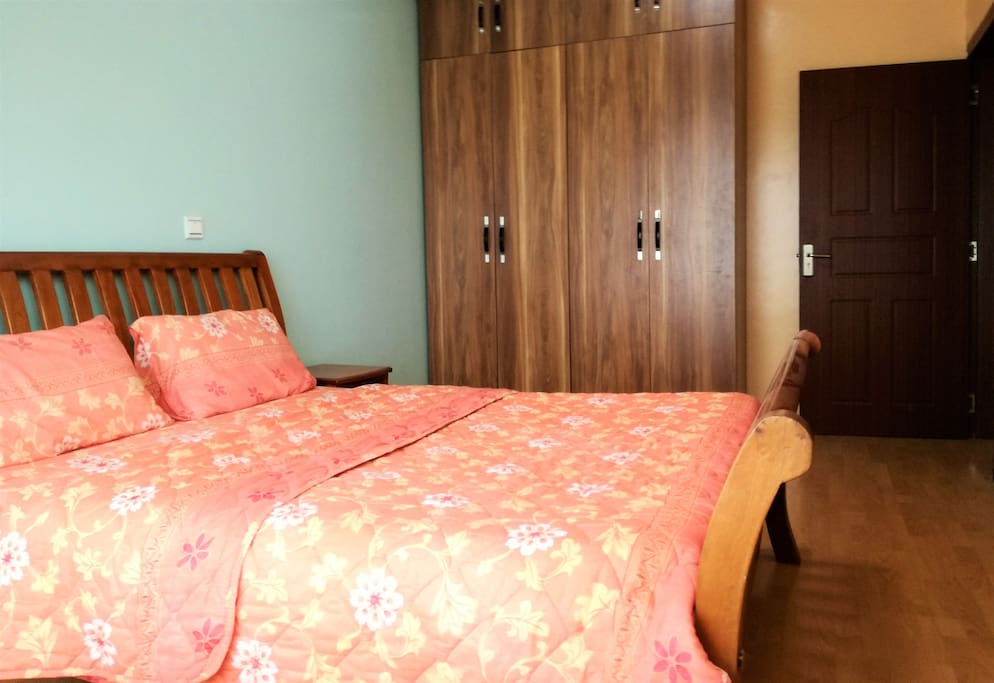 Room with queen bed and built in draws
