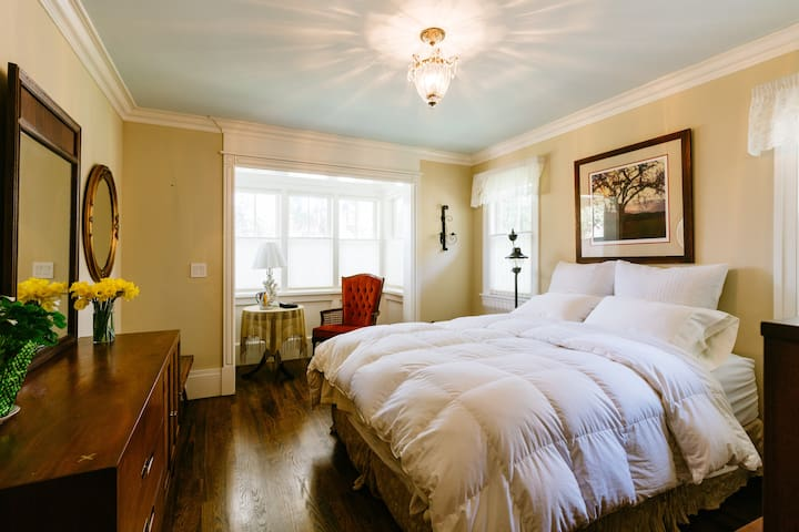 Bedroom with queen size bed and reading niche.