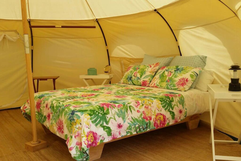 The tent has a comfortable queen bed with all bedding provided.