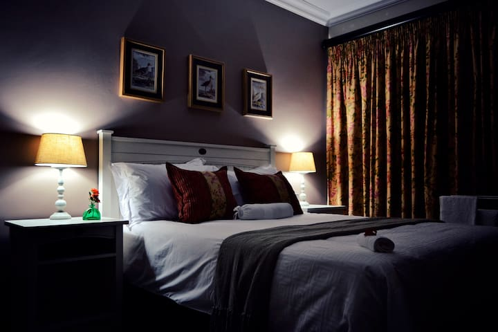 Queen bed with on suite shower. Coffee and tea facility and bar fridge in room