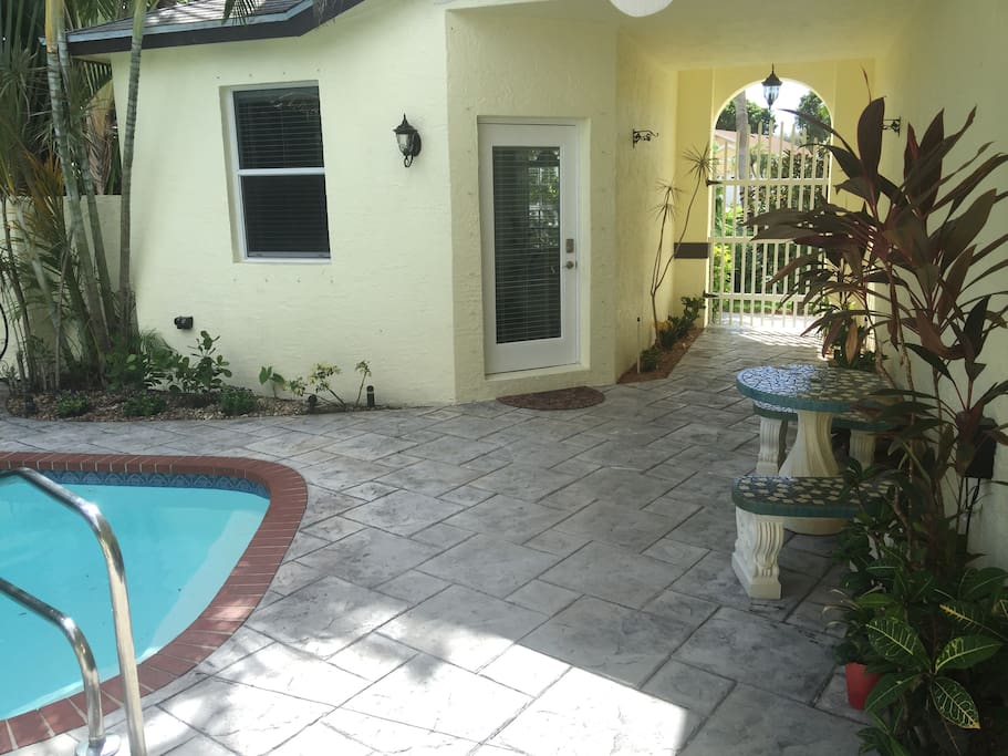 Private entrance in the courtyard, patio and pool.