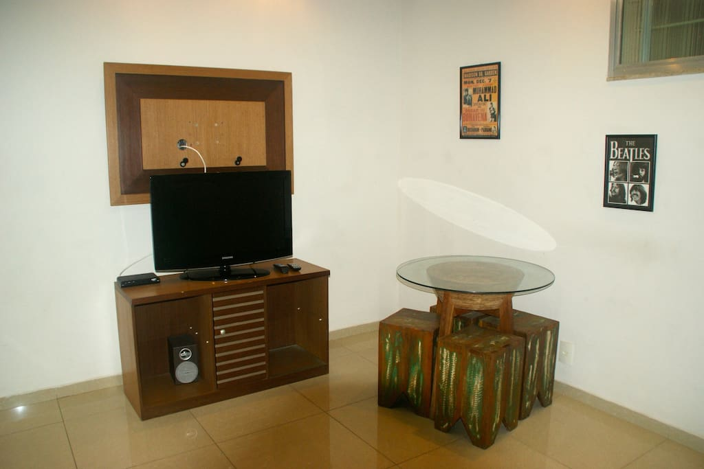 TV and table with four chairs