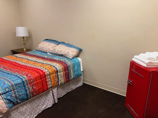 Bed with small refrigerator