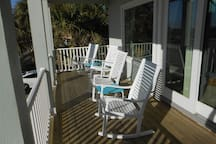 Enjoy a beach view while relaxing in front porch rocking chairs (west side of front porch)