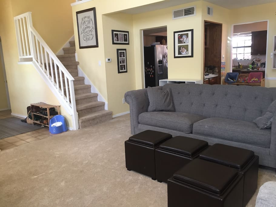 Spacious and social living room that opens into the kitchen. Laundry room downstairs across from downstairs bedroom.