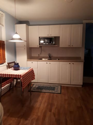 Fully equipped kitchen with table for two.  Laundry room access.