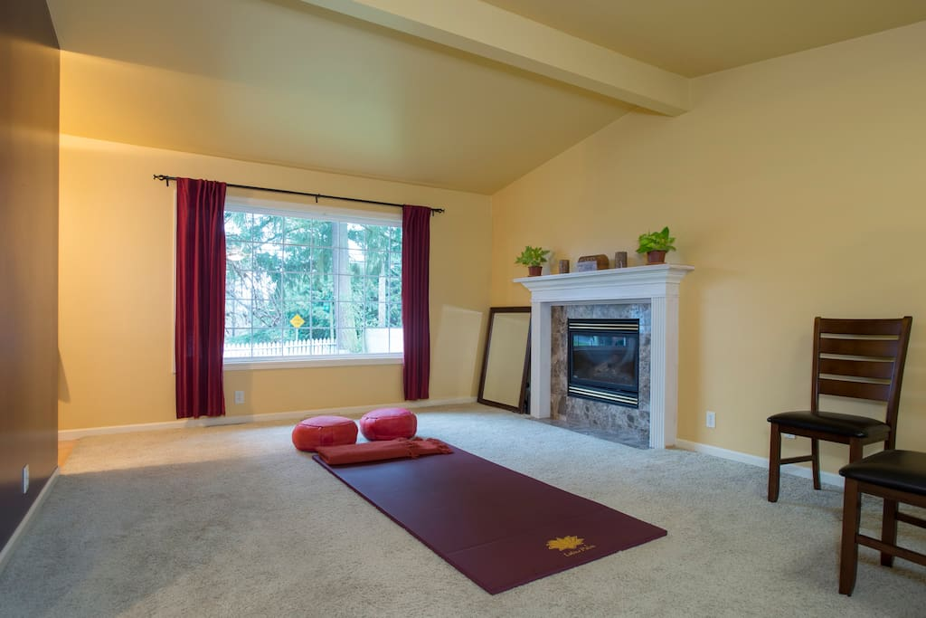 Relaxation room with with yoga-meditation mat, big window, open view onto front yard (added large 3 seater reclining white leather couch to room)