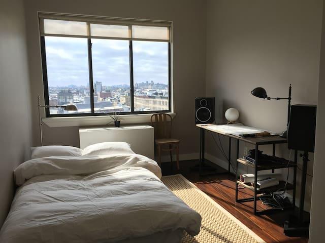Sunny room in Bushwick loft with skyline views