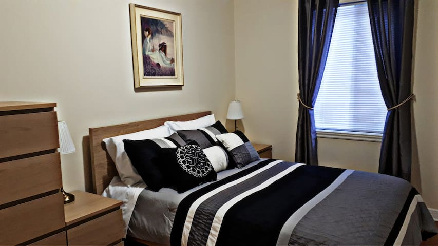 Second bedroom. Full Double bed, closet with hangers, 2 night tables with lights. Curtains and blinds on the window. Large access to the bed.