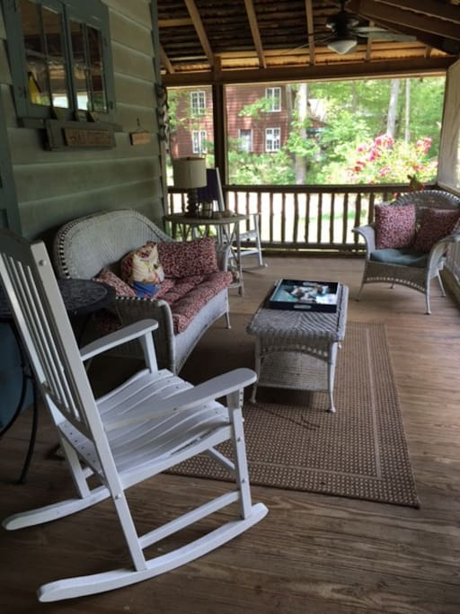 Porch living at its best with this new, screened in porch with comfy wicker and rockers!