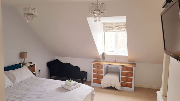 Spacious room with large ensuite in a family home.