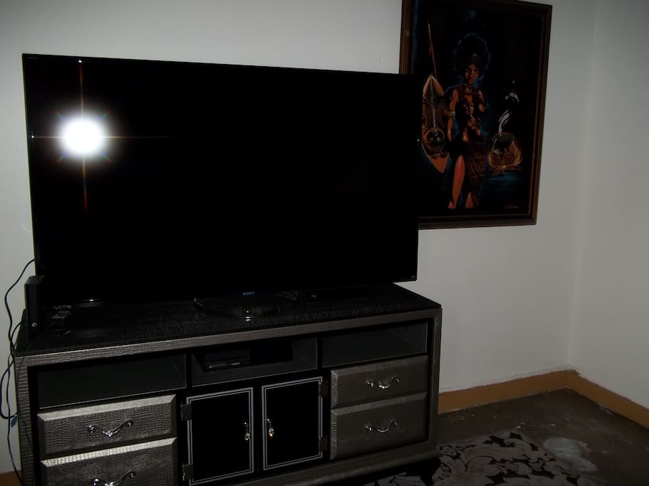 "This is a 70"" TV with stand."