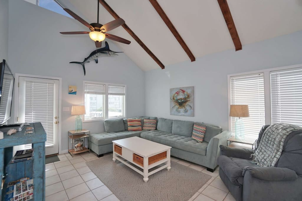 First floor living room with vaulted ceilings and sleep sofa