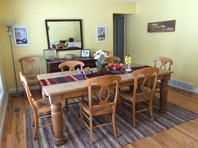 Inviting dining room with a variety of snacks to enjoy. This is a perfect place to eat or work with lots of natural light flooding in through the front window.