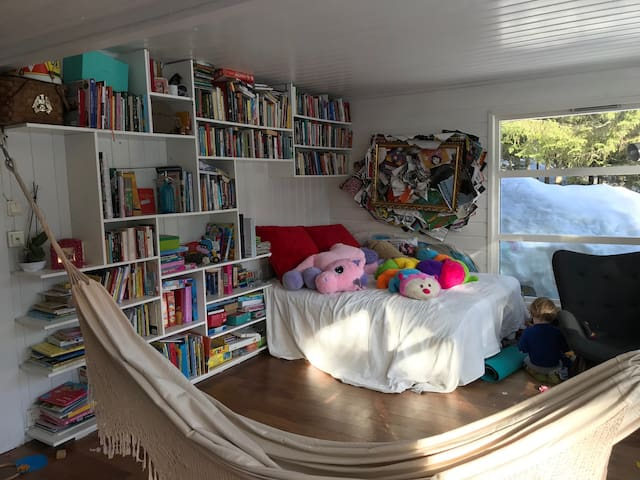 Queen size day bed and hammock in living room