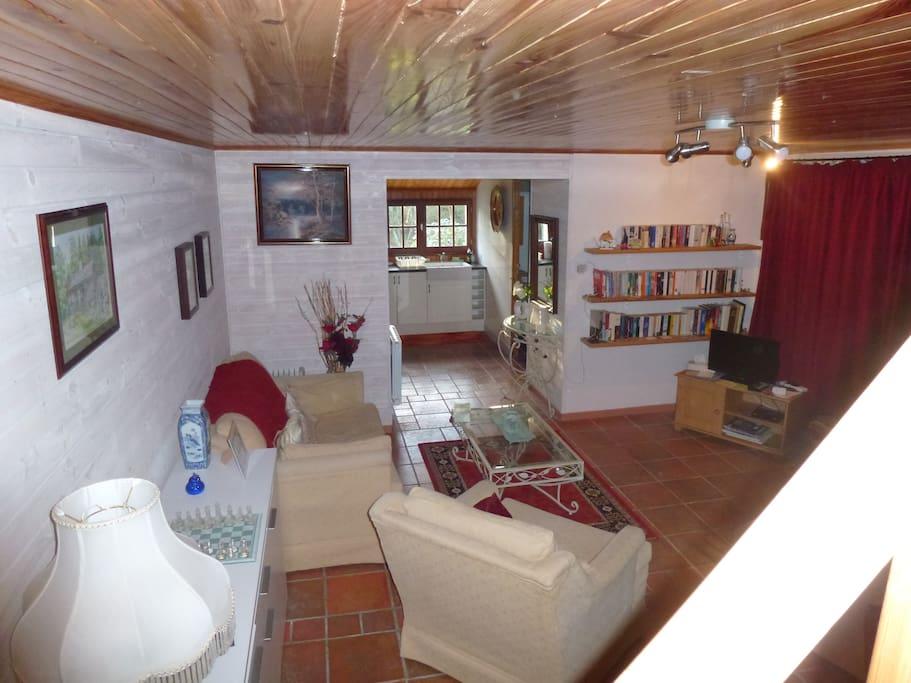 Gite lounge area through to kitchen